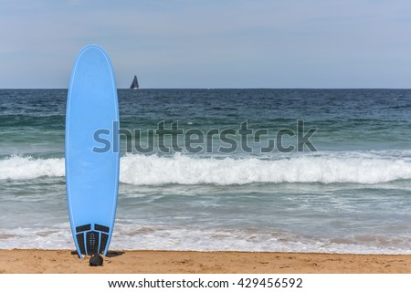 Beautiful beach with surf board at the Northern Beaches around Sydney, Australia