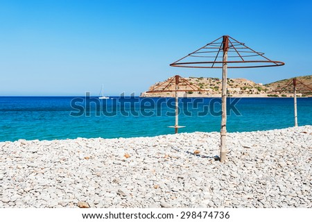 Beautiful beach with turquoise water and white pebbles. Plaka village, East coast of Crete island, Greece.  - stock photo