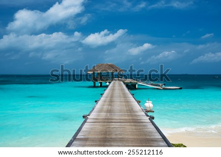 Beautiful beach with water bungalows at Maldives - stock photo