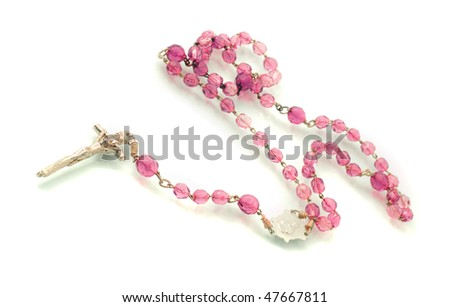 Beautiful Beads on white with focus on cross (shallow DOF) - stock photo