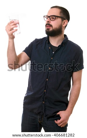 beautiful bearded man with glass of water isolated on white background - stock photo
