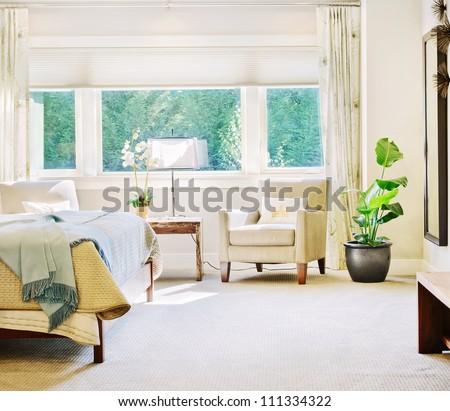 Beautiful Bedroom Detail in Luxury Home - stock photo