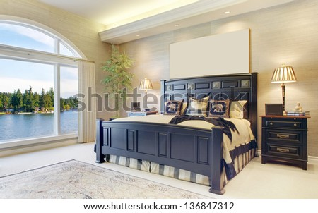 Beautiful Bedroom in Luxury Home - stock photo