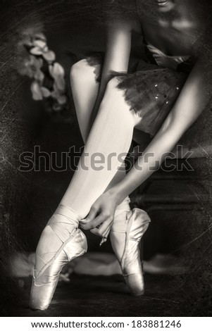 Beautiful bellet dancer posing at studio over vintage background. Black-and-white. - stock photo