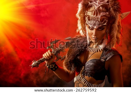 Beautiful bellicose Amazon with a sword in battle. Ancient times. Fantasy. - stock photo