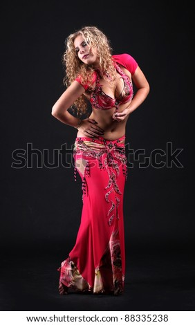 beautiful belly dancer woman isolated black background