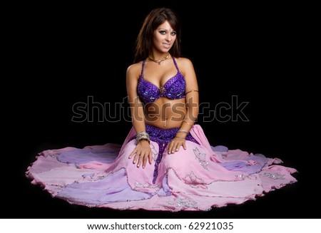 Beautiful belly dancer woman sitting - stock photo