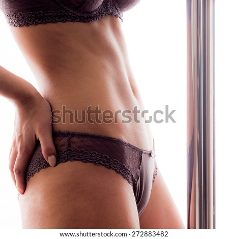 Beautiful belly of young pole dancer - stock photo