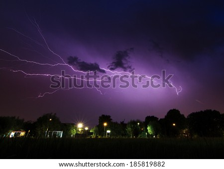 Beautiful big flash of lightning in the night sky over Baambrugge in the Netherlands
