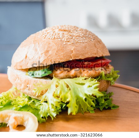 Beautiful big hamburger on a wooden table.