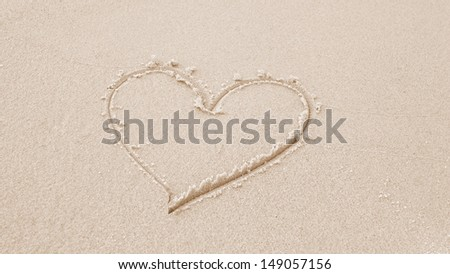 beautiful big heart in the sand at the beach