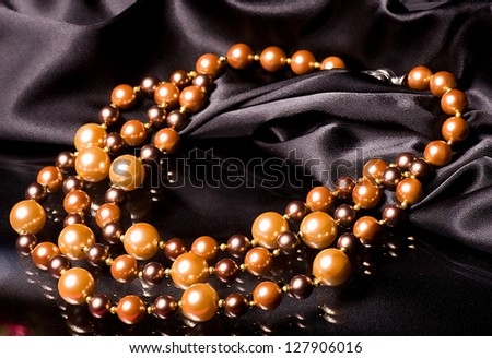 Beautiful bijouterie on black background - stock photo