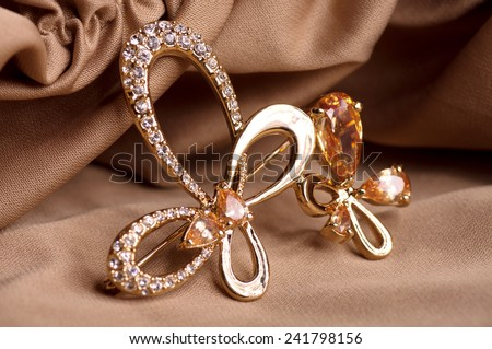 Beautiful bijouterie on brown background  - stock photo