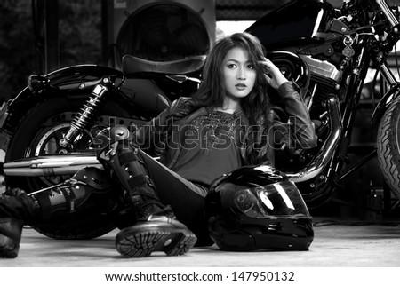 Beautiful Biker in studio shot. - stock photo