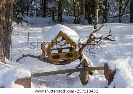 Beautiful bird feeder in the winter park. - stock photo