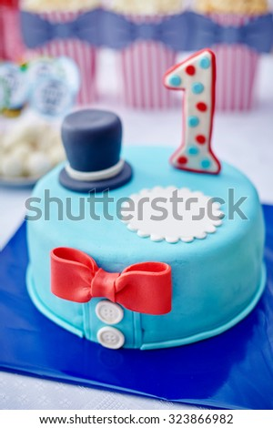 Beautiful birthday cake with number one above on the table. - stock photo
