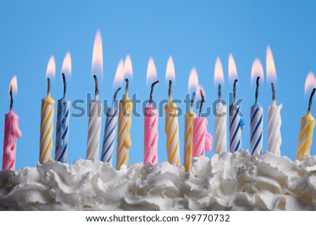 beautiful birthday candles on blue background - stock photo
