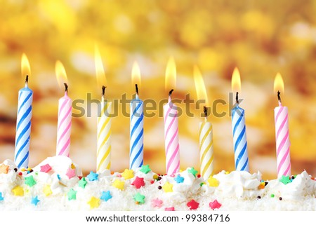 beautiful birthday candles  on yellow background - stock photo