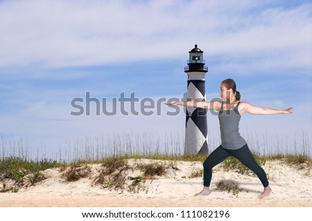 Beautiful black African American woman doing her Yoga stance exercises - stock photo