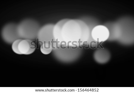Beautiful black and white blurred lights on a dark background - stock photo