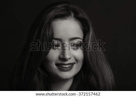 Beautiful black and white portrait of a young woman - stock photo