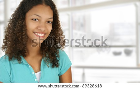 Beautiful black college student on campus in front of window. - stock photo