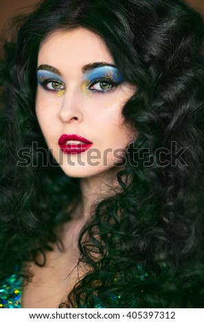 Beautiful black-haired girl with bright;makeup and glitters, bachelorette party, cocktail party, closeup portrates