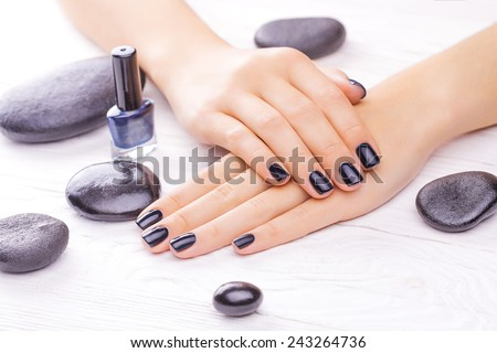 beautiful black manicure with black stones on the white - stock photo