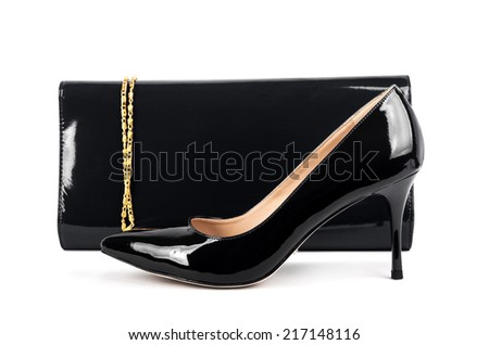 Beautiful  black shoes with clutches on white isolated background - stock photo