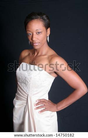 Beautiful black woman in white dress - stock photo