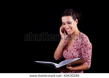 beautiful black woman on the reading information, isolated on black background - stock photo