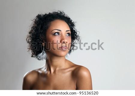Beautiful black woman posing in a studio .Erotic art photo - stock photo
