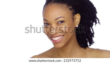 Beautiful black woman showing off her pearly whites - stock photo