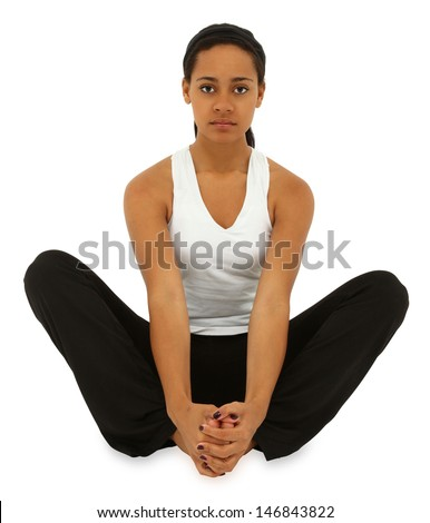 Beautiful black woman sitting yoga style over white floor eyes open with clipping path. - stock photo