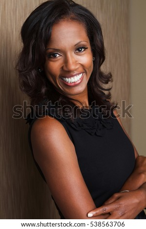 Beautiful black woman smiling at the camera.