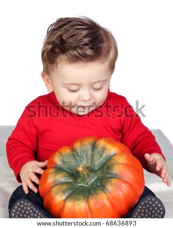 Beautiful blond baby with a big pumpkin isolated on white background - stock photo