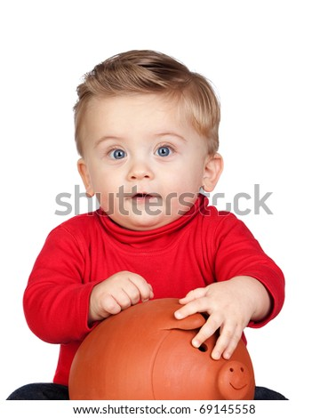 Beautiful blond baby with a piggy-bank isolated on white background - stock photo