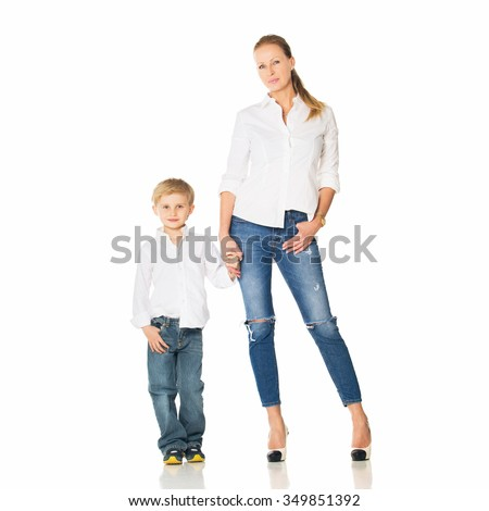 Beautiful blond boy in a shirt and his mother standing in the studio. Isolated on white background - stock photo