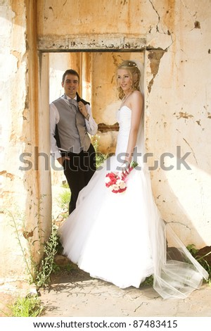 Beautiful Blond bride and her groom on their wedding day - stock photo