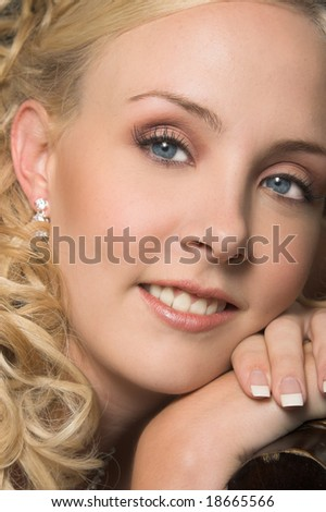 Beautiful Blond bride wearing diamond jewelery