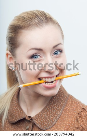 Beautiful blond business woman isolated on white background holding pencil in her mouth