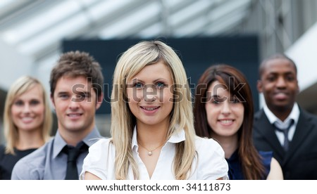 Beautiful blond businesswoman in front of her team