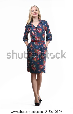 Beautiful Blond Busyness Woman Fashion Model in office floral dress