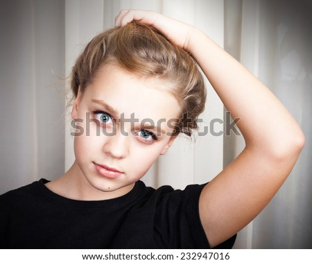 Beautiful blond Caucasian girl, close up studio portrait - stock photo