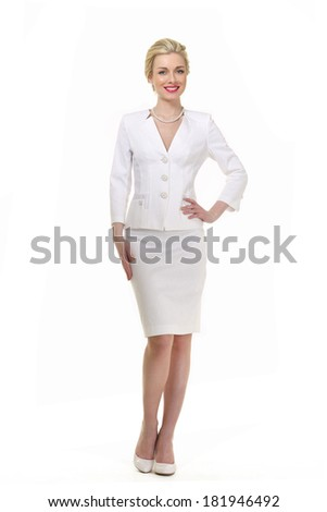 beautiful blond executive business women in summer white suit and white shoes