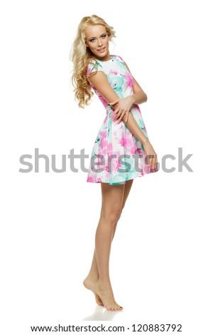 Beautiful blond female in full length posing in summer dress over white background - stock photo