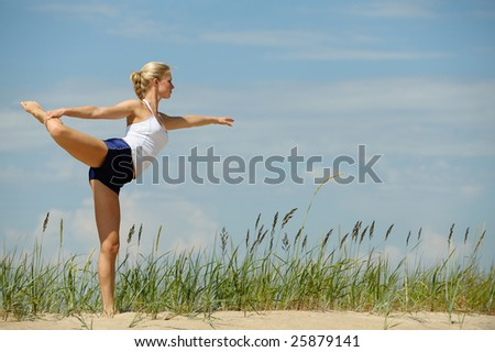 Beautiful blond female workout on the beach