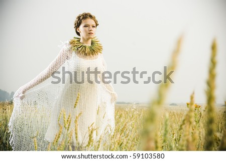 beautiful blond girl at the field - stock photo