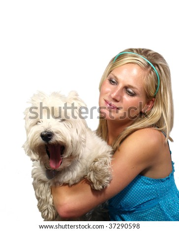 Beautiful blond girl holding west highland terrier on white background