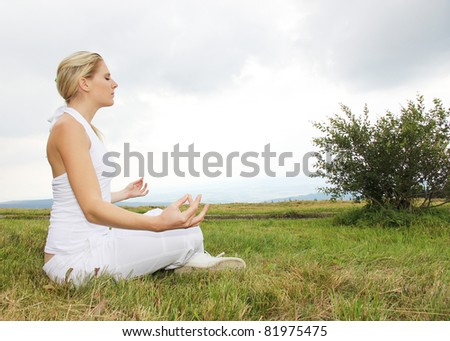 Beautiful blond girl in meditation